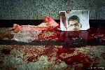 Een foto van ex-president Mohammed Morsi in een plas bloed. Foto: Ester Meerman